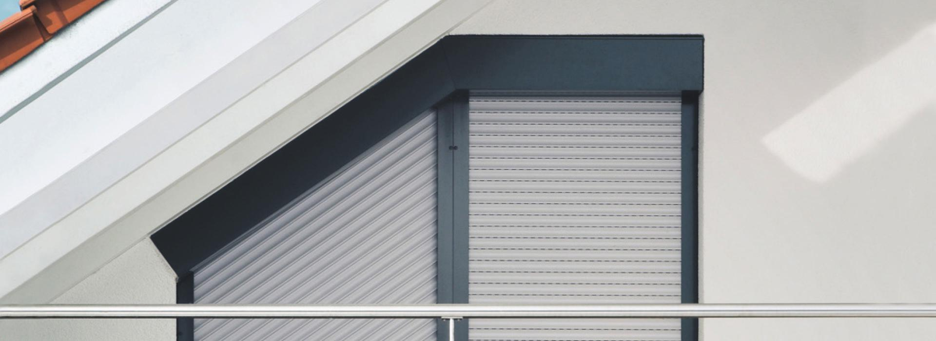 Window close-up roof slope with angled roller shutter TRENDO