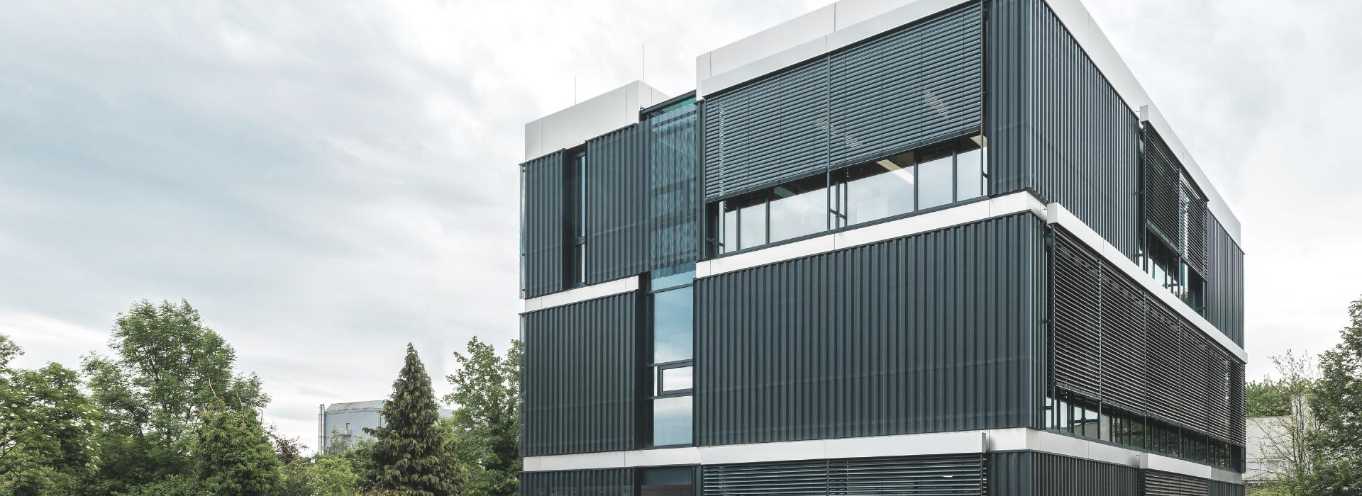 Modern office building with façade venetian blinds by daylight